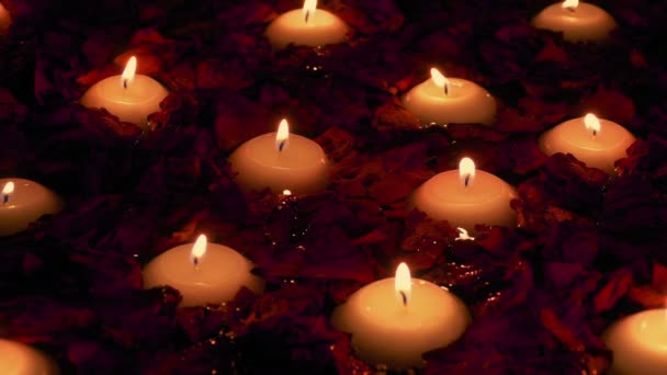 Candles And Rose Petals Floating In Spa
