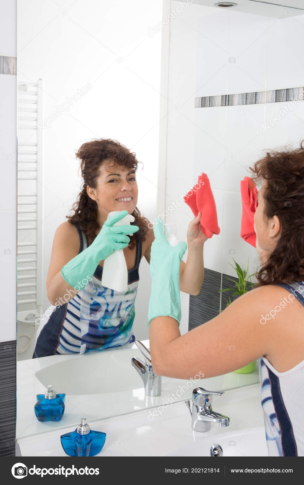 Cleaning Lady Cleans Rubs Mirror Bathroom Stock Photo Sylvrob - Bathroom cleaning lady