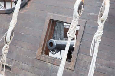 detail on a pirate ship in replica with the cannons