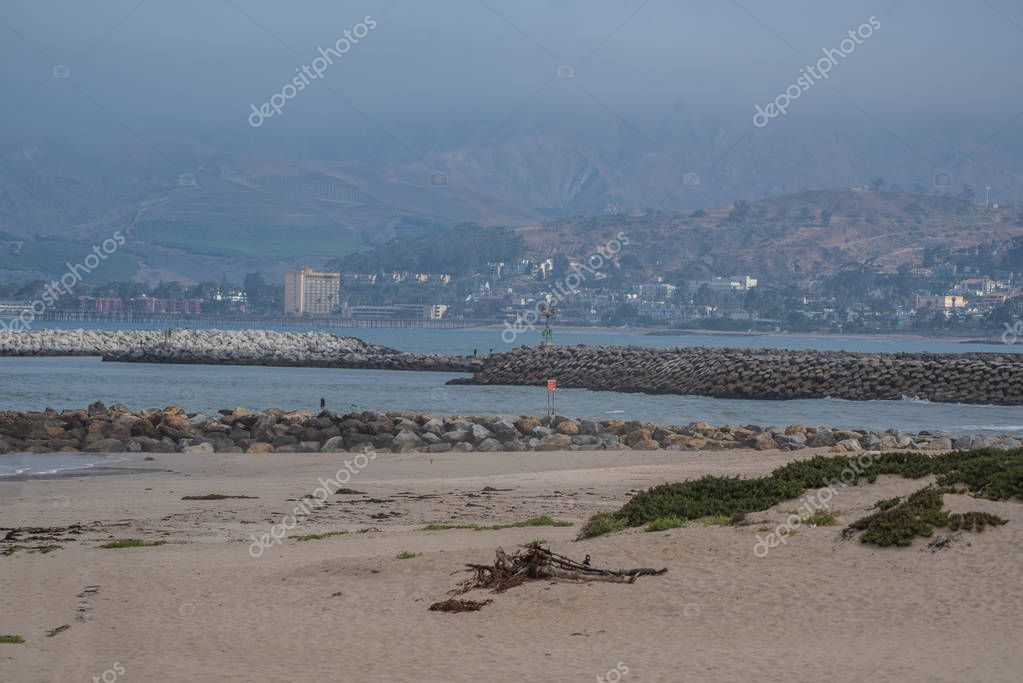 View across the harbor mouth of Ventura as morning fog lifts off the hills above the Crowne Plaza Hotel on July 14, 2018 in California.