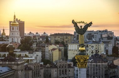 View of the street Khreshchatyk and Independence Square in Kiev from a bird's eye view. Monument of Independence at sunset time