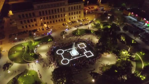 Aerial: The new fountain nearby the Regional Center of Youth Culture building, night time