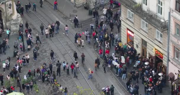 Lviv, Ukraine - October 20 2018: Crowd of people are walking on the Market Square, view from tower of City Hall