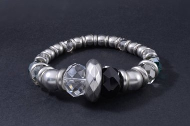 silver bracelet with gems isolated on black