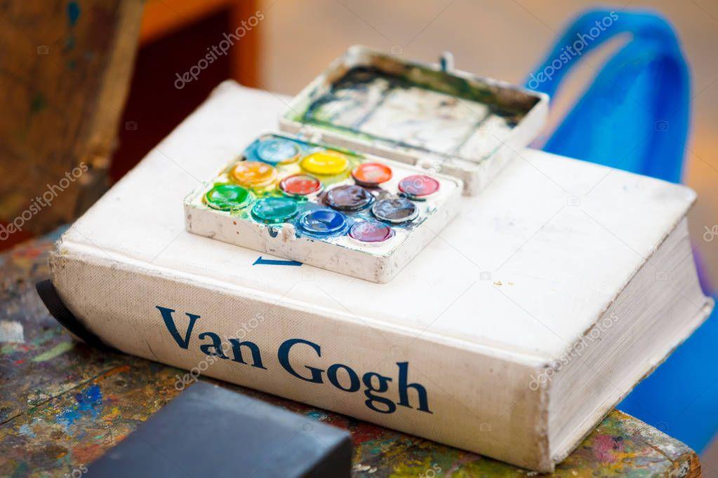 Watercolor on Van Gogh book in classroom