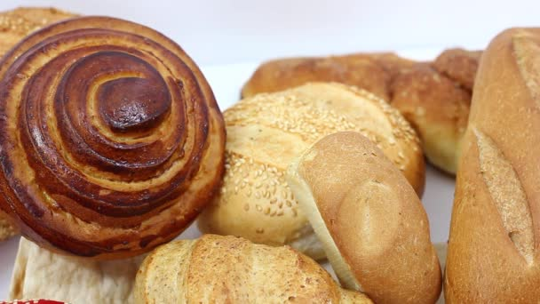 close up view of delicious fresh assortment with pastry and bread on white the table