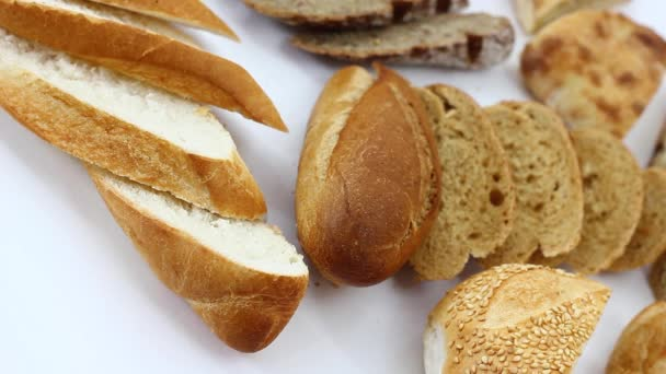 closeup view, variety of tasty fresh bread pieces on white table