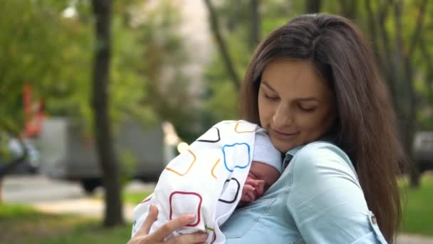 Mother and her Newborn Baby. Happy Mother holding her Baby. Maternity concept.