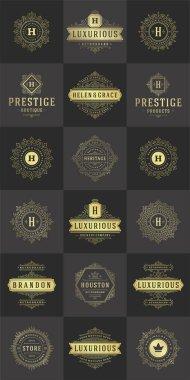 Luxury logos templates set, flourishes calligraphic elegant ornament lines. Business sign, badges and monograms for elegant crest, boutique brand, royal restaurant, hotel sign, fashion designer.