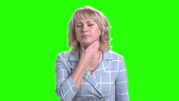 Mature woman suffering from sore throat.