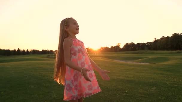 Happy girl on green meadow.