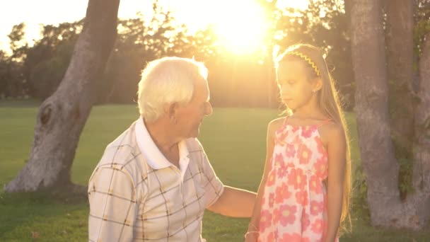 Girl with grandpa outdoors.