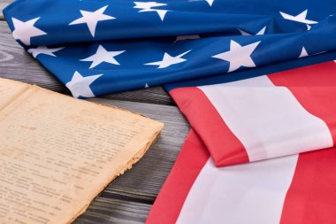 Folded flag of USA and old book.
