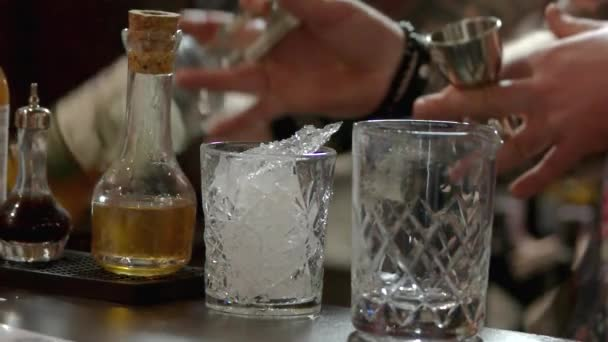 Pouring liquor in the metal goblet.