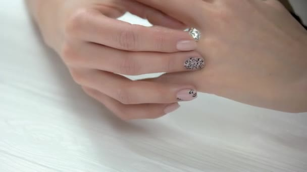 Female manicured hands and luxury ring.