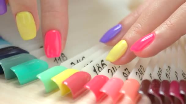 Manicured finger nails and nail samples.