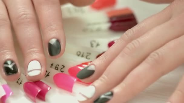 Manicured fingers and nails color samples.