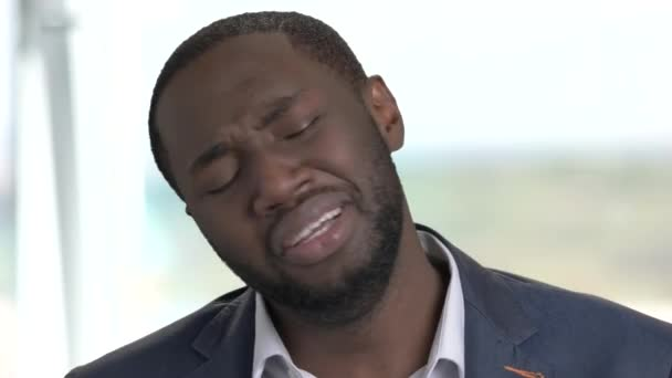 Close up afro-american businessman is crying.