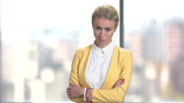 Displeased business woman on blurred background.