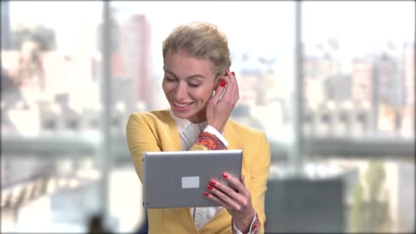 Attractive business lady talking via internet.
