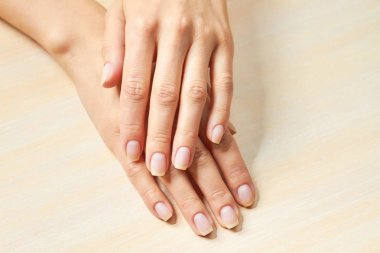 Beautiful gentle woman hands. Young woman clean and delicate hands. Spa and manicure concept.
