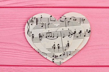 Collection of paper hearts with musical notes.