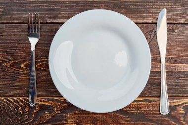 Table setting with plate, fork and knife.