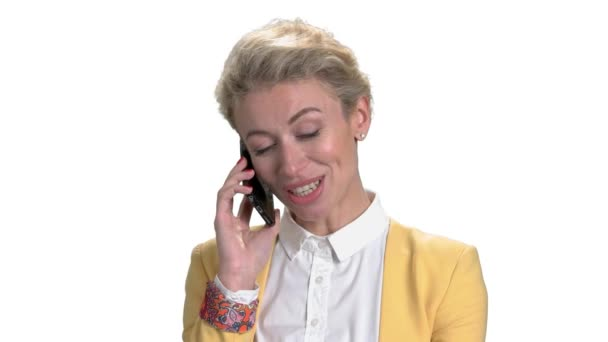 Portrait of mature businesswoman talking on phone.