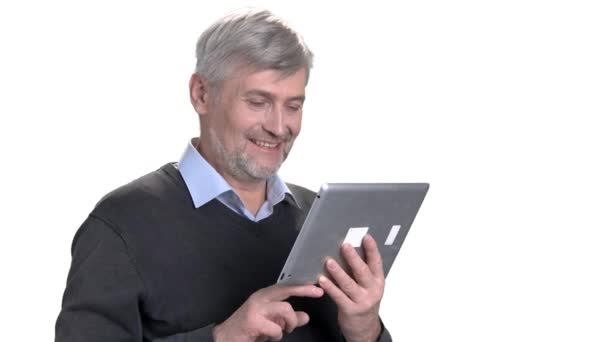 Happy smiling middle-aged man using digital tablet.