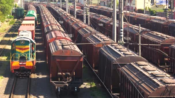 Many freight train wagons.