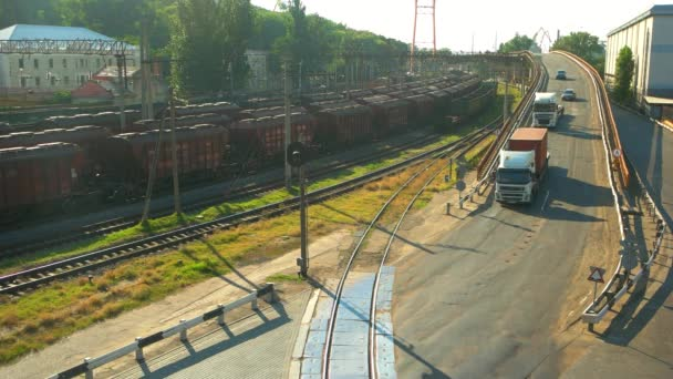 Freight cargo trains and trucks.