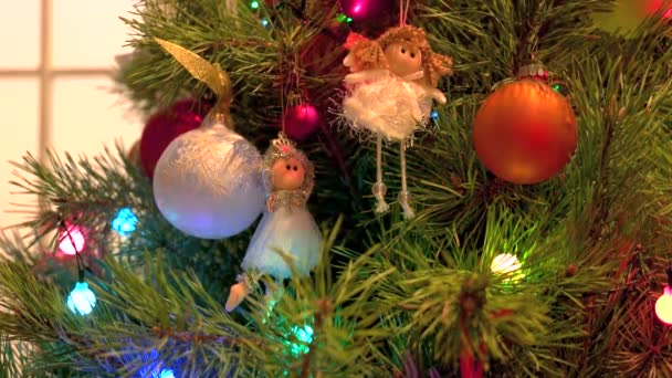 Beautiful ornaments hanging on Christmas tree.