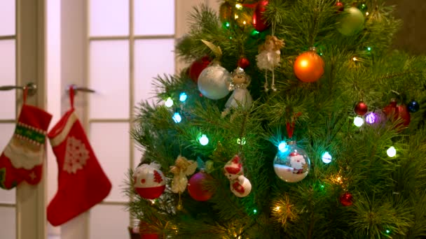 Christmas tree decorated with balls and angels.