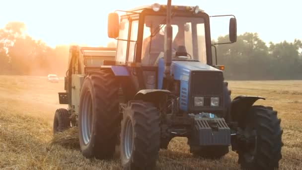 Blue Tractor working in the agricultural field.