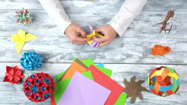 Making colourful origami flower.