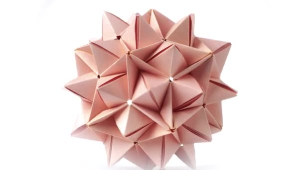 Beige origami transforming spiky ball.