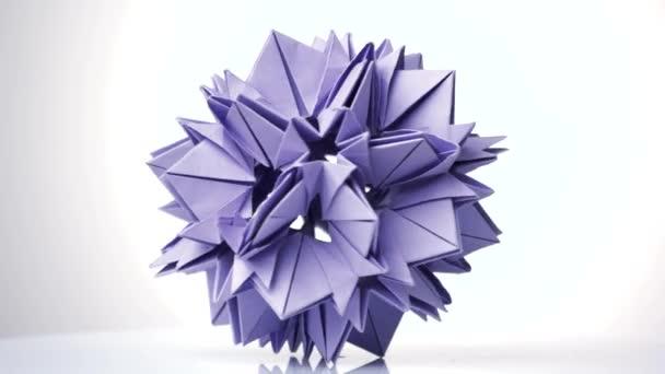 Purple origami transforming spiky ball.