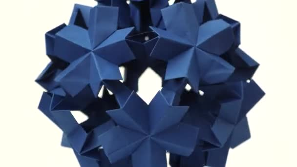 Blue origami transforming spiky ball.