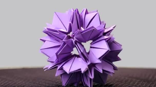Purple origami sharp ball exposition.