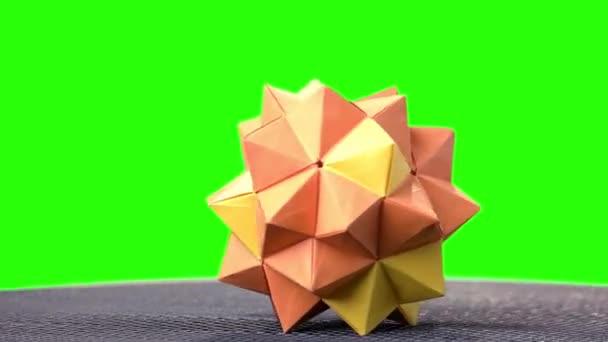 Orange origami spiky ball exposition.