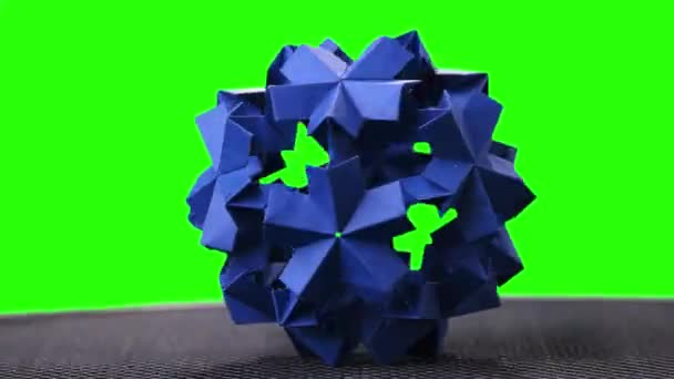 Blue origami spiky ball exposition.