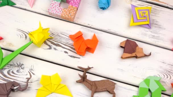 Exposition of origami figures on wood.