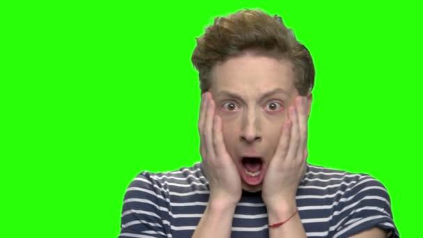 Shocked and surprised teenage boy.