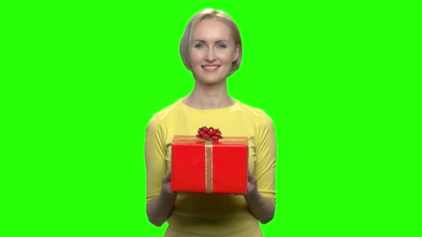 Beautiful adorable woman holding red gift box.