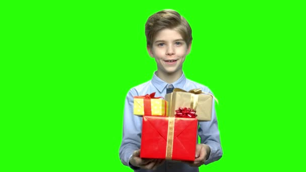 Cute child boy giving many gift boxes for your birthday.