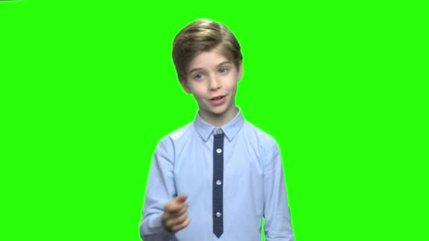 Smart little boy speaking to audience.