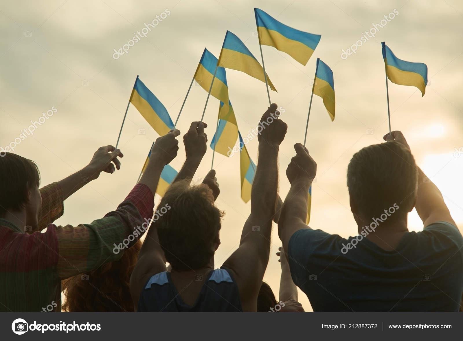People hold ukrainian flags  — Stock Photo © Denisfilm #212887372