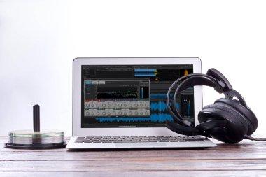 Laptop, headphones and disks.