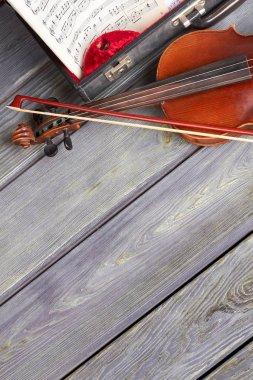 Violin and musical notes sheets.