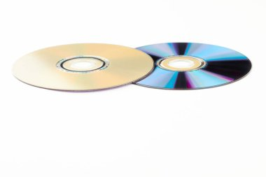 Two compact discs on white background.